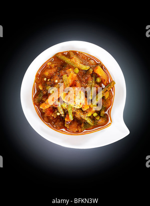 Vegetable curry with green chili, mint and coriander - Stock Photo