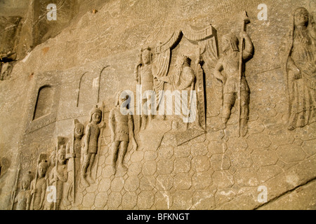 Carving of figures of miners on the wall in the Saint Kinga's Chapel in the Wieliczka Salt Mine. Near Krakow, Poland. - Stock Photo