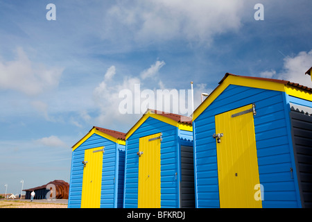 Blue yellow beach huts on the seafront of East Beach Cafe, Littlehampton, West Sussex, England, Britain - Stock Photo