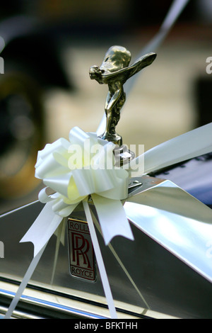 The Spirit of Ecstasy, also called 'Silver Lady' or 'Flying Lady' hood ornament on Rolls Royce cars decorated for - Stock Photo