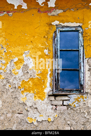 Old weathered painted wall and window for grunge background - Stock Photo
