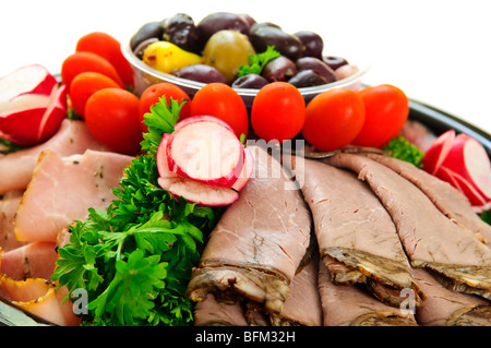 Platter of assorted cold cut meat slices - Stock Photo