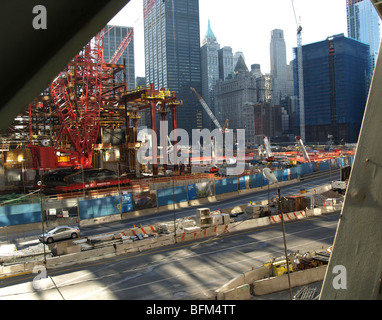 New York Ground Zero and the rebuilding work starting to emerge from the footings - Stock Photo