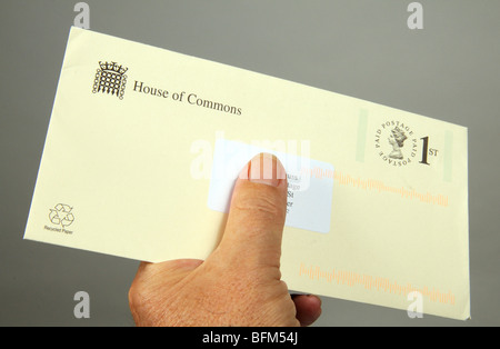 1st class postage paid Royal Mail label on House of Commons envelope - Stock Photo