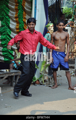 A man dancing at a temporary Diwali temple in Kolkata (Calcutta) West Bengal, India - Stock Photo
