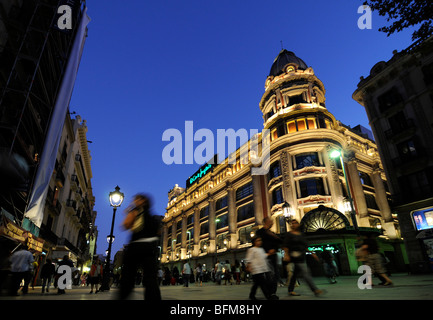 People hanging out on Las Ramblas in Barcelona, Spain. - Stock Photo