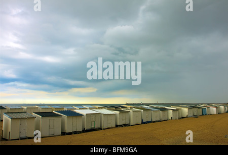 Wooden beach houses in a row - Stock Photo