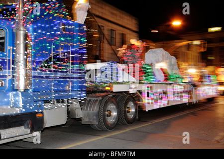 Truck with Xmas lights in 2009 Victoria Santa Claus parade through downtown-Victoria, British Columbia, Canada. - Stock Photo