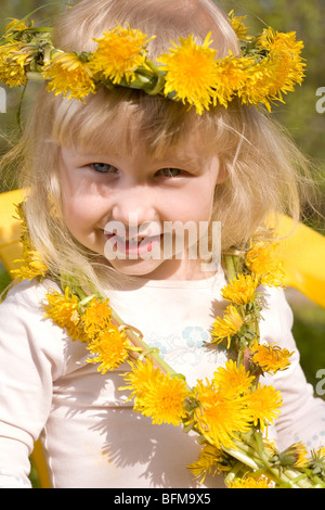 little girl in flower wreath close-up portrait - Stock Photo