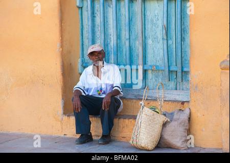Old Man smoking cigar in Trinidad, Cuba - Stock Photo