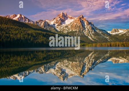 USA, IDAHO, Sawtooth National Recreation Area. Sawtooth Mountains, Snow covered McGowen Peak reflecting in Stanley - Stock Photo