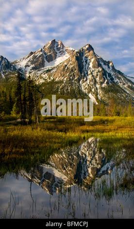 USA, IDAHO, Sawtooth National Recreation area, Sawtooth Mountains,  Snow covered McGowen Peak reflecting in Stanley - Stock Photo