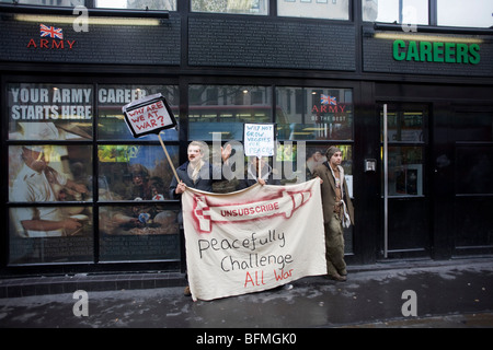 Anti-war protesters outside British Army recruitment office in central London. - Stock Photo