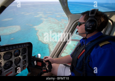 Australia, Great Barrier Reef. Helicopter flight over Hardy Reef near the Whitsunday Islands. - Stock Photo