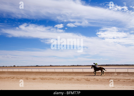Australia, Queensland, Birdsville.  A horse rider on the dirt track at Birdsville during the annual Birdsville Cup - Stock Photo