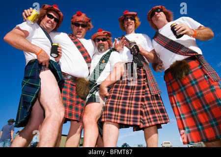 Australia, Queensland, Birdsville.  Race goers in costume dress for the fun of the Birdsville Races. - Stock Photo