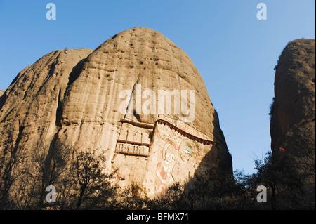 China, Gansu Province, Shuilian Dong Water Curtain Cave, Sakyamuni rock sculptures Lashao temple, Northern Wei dynasty - Stock Photo