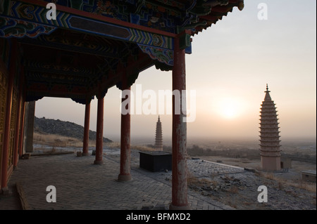 China, Ningxia Province, Baishikou near Yinchuan, sunrise at the Twin Pagodas - Stock Photo