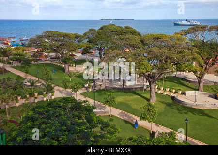 Tanzania, Zanzibar, Stone Town. The attractive Forodhani Gardens grace the seafront in front of Beit al-ajaib, House - Stock Photo