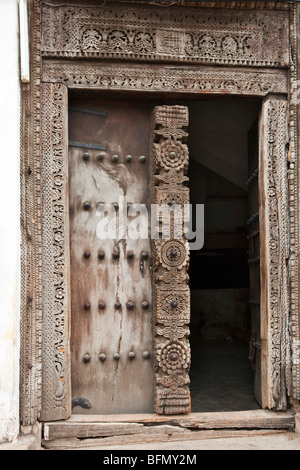 Tanzania, Zanzibar, Stone Town. A fine old carved wooden door of a house in Stone Town. - Stock Photo