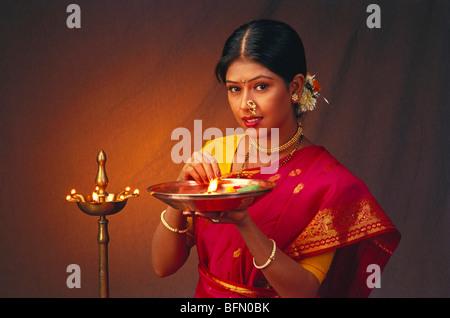 RHS 60868 : Hindu lady holding pooja thali in hand ; India MR#138 - Stock Photo