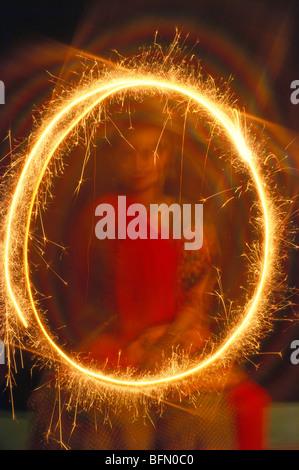 Diwali festival ; child burning sparkler ; Bombay ; Mumbai ; Maharashtra ; India ; Asia - Stock Photo