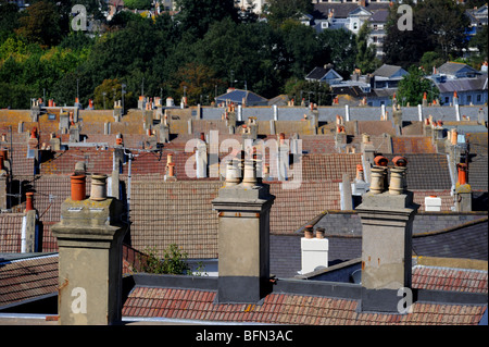 Chimney stacks on top of roofs of houses in brighton - Stock Photo