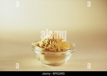 NVM 61506 : Ayurvedic herb ; ashwagandha churan in glass bowl on white background improves nervous system - Stock Photo