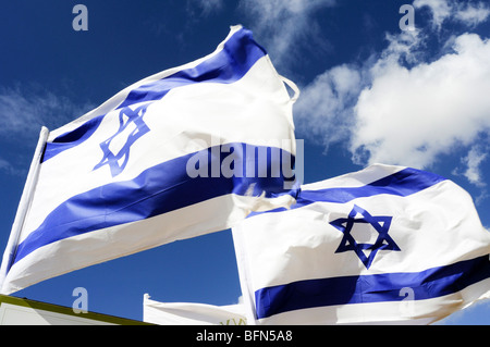 Israeli Flags waving in the wind - Stock Photo