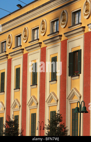 Colourful facade of government buildings at Skanderbeg Square in Tirana, Albania - Stock Photo