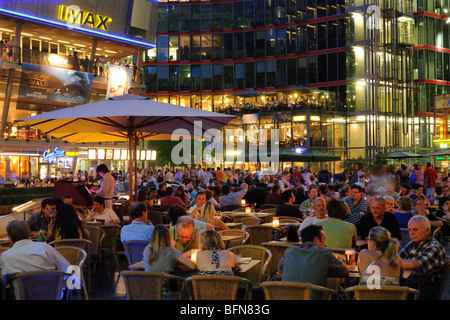 Atrium and interior of Sony Center. Restaurants and cafes under the tent roof on a summer night. Potsdamer Platz. - Stock Photo