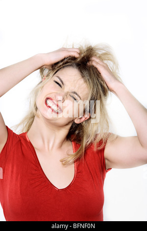 studio shot portrait isolated of young blond long hair woman in hairstyle distress - Stock Photo