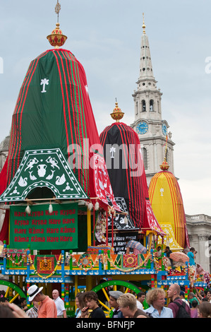 Three decorated chariots at the celebrations of Ratha Yatra  The Hindu festival of chariots in London UK - Stock Photo