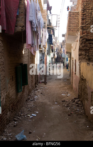 Washing hangs to dry in a back street in a poor part of Luxor Egypt. - Stock Photo