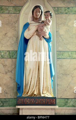 Holy Statue of the Virgin Mary holding the baby Jesus in Saint Malachy's Church Belfast. - Stock Photo