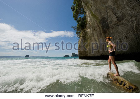 A swimmer in Cathedral Cove near Hahei. - Stock Photo