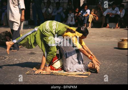 NGS 62719 : Indian women street performance acrobat ; Bombay Mumbai ; Maharashtra ; India - Stock Photo