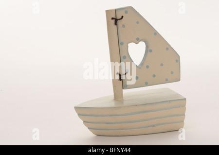 White wooden boat on white background - Stock Photo