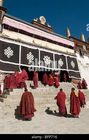 Monks in front of the main prayer hall at the famous Drepung Monastery, the largest in Lhasa Tibet. - Stock Photo