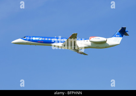 Embraer ERJ-145 operated by BMI  climbing out after take off from Birmingham Airport, UK. - Stock Photo