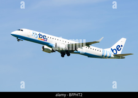 Embraer ERJ-190 operated by Flybe climbing out after take off from Birmingham Airport, UK. - Stock Photo
