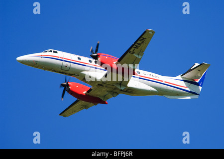 BAe Jetstream 41 operated by Eastern Airways climbing out after take off from Birmingham Airport, UK. - Stock Photo