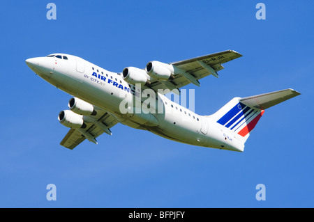 Avro RJ85 operated by Cityjet on behalf of Air France climbing out after taking off from Birmingham Airport, UK. - Stock Photo