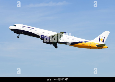 Airbus A321 operated by Monarch Airlines climbing out after take off from Birmingham Airport, UK. - Stock Photo