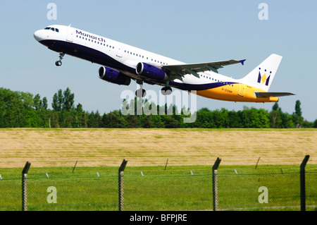 Airbus A321 operated by Monarch Airlines taking off from Birmingham Airport, UK. - Stock Photo