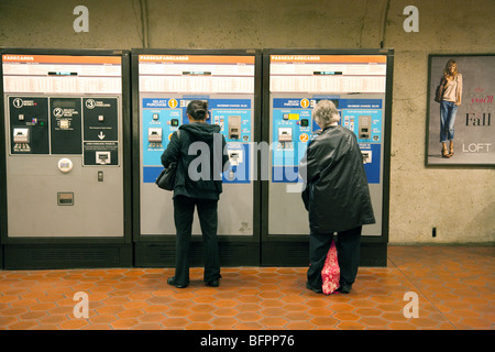 Passengers buying tickets from machines, the metrorail or metro underground rail system, Washington DC USA - Stock Photo