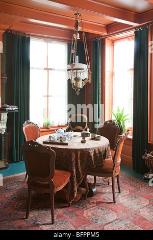 Victorian parlour with table and chairs Zuiderzeemuseum Enkhuizen Netherlands - Stock Photo