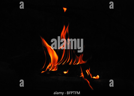 A flame is the visible (light-emitting) part of a fire at Mulshi. - Stock Photo