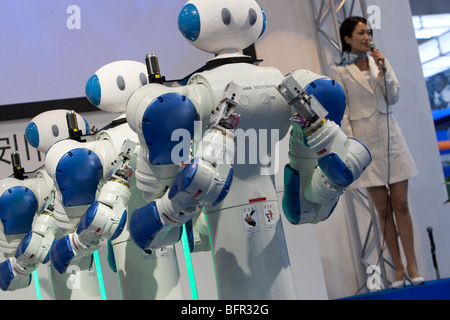 'Motoman' robots produced by Yaskawa, at the International Robot Exhibition 2009, in Tokyo, Japan. - Stock Photo