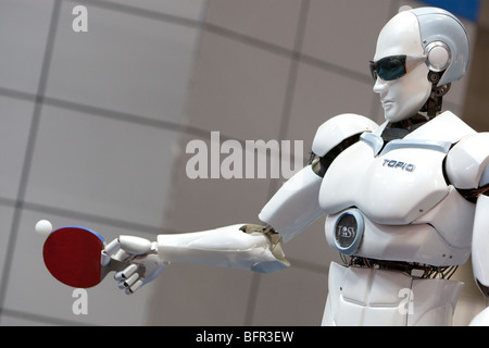 'TOPIO' a ping pong playing robot, produced by Vietnamese company Tosy, at the International Robot Exhibition 2009 - Stock Photo